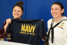 Student signing with Navy
