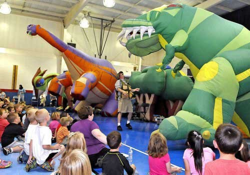 DinoMan and his inflatable dinosaurs