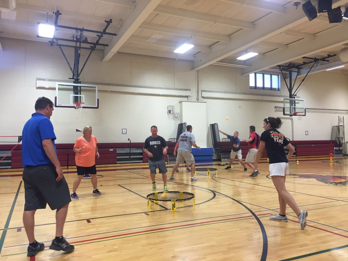 Physical education teachers on basketball court