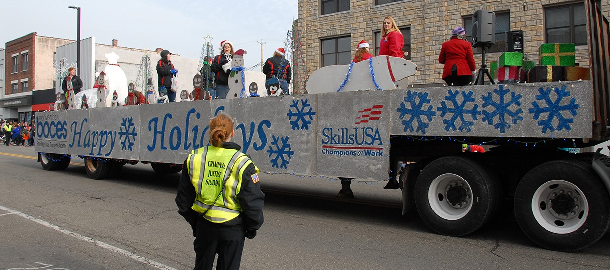 SkillsUSA Leadership float passes down the avenue during Endicott's holiday parade