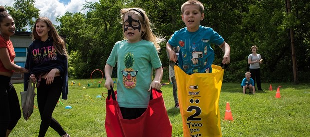 Kids compete in sack race at carnival