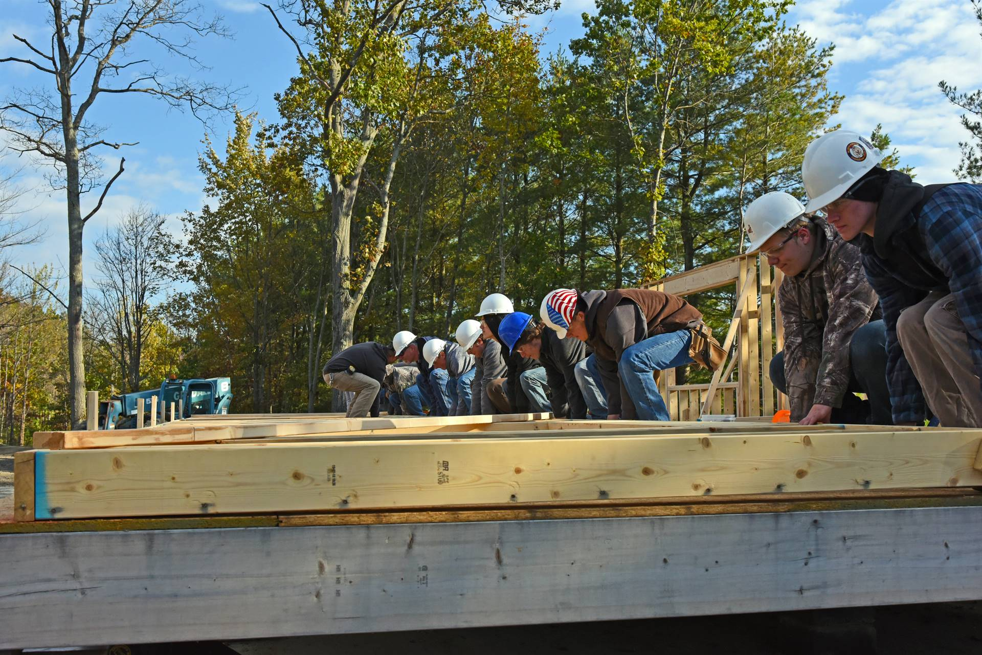 Students raise walls for Habitat house