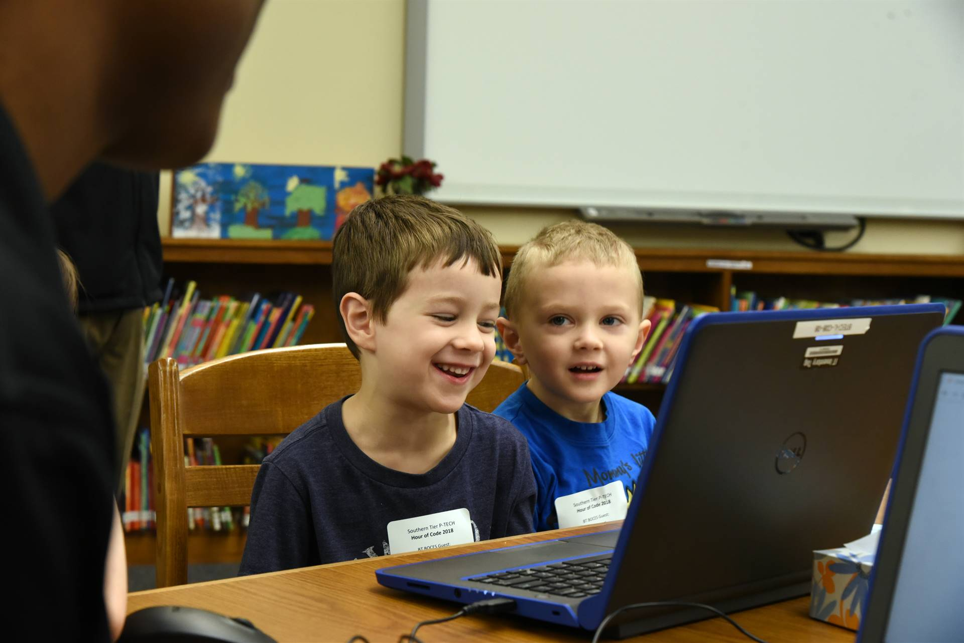 Preschoolers learning coding with P-TECH students