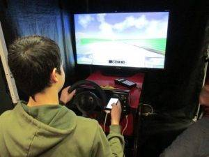 Student using driving simulator
