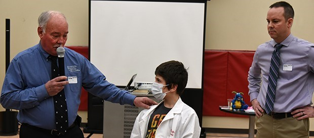 Father and son doctors Sam and Eric Ruffo visit PALS students for Dental Health Month